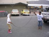 Kids play in the parking lot while the parents do some shopping