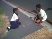 Kids playing in the street in front of the library
